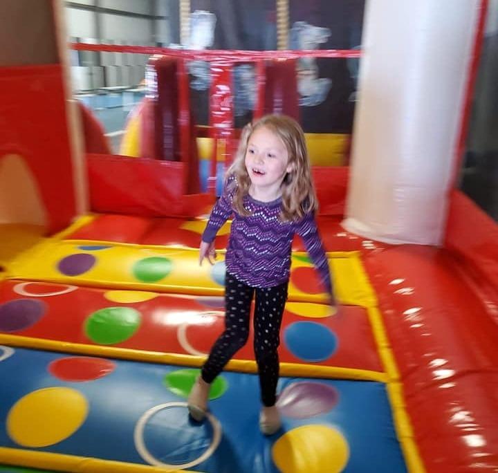 Kids having fun bouncing in a bounce house